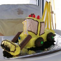 Excavator Cake  The cake is just a frozen pound cake. the front and back loaders are twinkies, the wheels are donuts with m&ms in the middle. the rods...