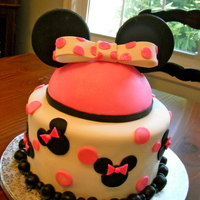 Minnie Mouse  I made this cake for my cousin's 4th birthday because every time she comes over, she gets my minnie mouse hat i got from Disney World...