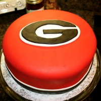 Uga Cake   all decorations are fondant. I use Duff Goldman's brand of fondant and I bought it pre colored which helped a lot.