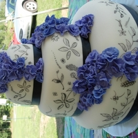 Black Food Marker Wedding Cake this is a fondant covered cake which I free handed drew the flowers on using a black food marker., The round layers are offset to the back...