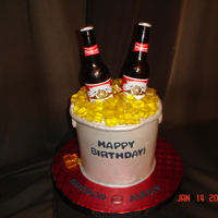 Beer Bucket Cake is chocolate with cheesecake filling and rum buttercream. Ice is gelatine, bottles are real.