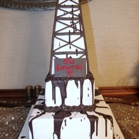 "Oil Derrick Cake  The bottom tier is a 12"" square cake and above is a 6"" square cake. The oil derrick is made of rice crispies, covered with..."