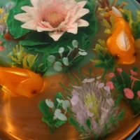 Realistic Fish Pond 100% gluten free - this cake has molded fish and all flowers and underwater sea flowers and weeds are done by injecting colored milk based...