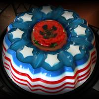Patriotic *Bundt style Gelatin cake in Cherry and vanilla flavors = the poppy in the middle is 100% gelatin as well. Made by infusing colored gelatin...