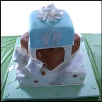 Baby Feet Three tier baby shower cake. 12/8/6in squares. gumpaste bows & fondant ribbon, baby feet and dots. painted with luster dust
