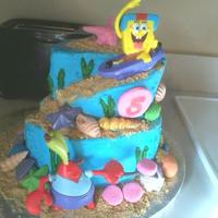 Spongebob Skating In Bikini Bottom all buttercream with fondant shells. Characters are plastic