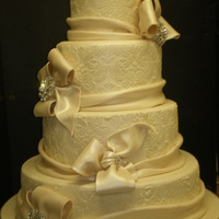 "Damask And Bows Wedding Cake This was done for a bride that was to appear on TLC's ""Four Weddings""."