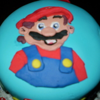 Super Mario! vanilla cake, vanilla icing, satin ice fondant. i made this for my friend's little girl who LOVES super mario.
