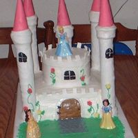 "Princess Castle  This is a 12"" square and a 6"" round cake, cake is iced in buttercream with mmf accents. The towers are paper towel holders with..."
