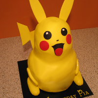 Pikachu vanilla sugar cookie cake w/oreo filling, RKT head. had a lot of issues with this cake, covered head 3 times to get smooth, there's a...