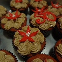 Bday Cuppies Red velvet cuppies, cc frosting, gumpaste flowers. TFL!