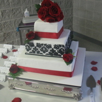 Black/white/red Wedding Cake My first wedding cake! Design inspired by a Madisons on Main cake. Pound cake, strawberry glaze, cheesecake buttercream filling, fondant...
