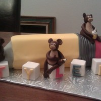 Pencil And Monkeys   Fondant covered Pencil cake with blocks and monkeys holding a book, pencil and cupcake.