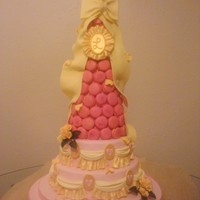 Macaron Tower Wedding Cake Wedding cake I made in 2010, just came across the pictures today. French macaron tower with touches of magenta petal dust on the macarons....