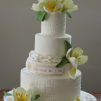 Textured Fondant Tulip Wedding Cake  GP tulips and leaves. Bottom and top tier are a texture I developed after seeing a piece of machined metal in a similar pattern. Ivory...
