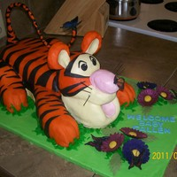 3D Tigger And Butterflies Orange Dream Cake with orange marmalade butter cream icing, covered in fondant.