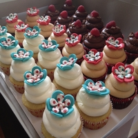 Aqua & Red Polkadots Cupcakes for a 60th Birthday Party! Chocolate Cupcake filled with Raspberry Curd topped with Chocolate Cream Cheese Icing, Vanilla...
