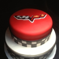 Corvette Themed Birthday Cake  Bottom tier is chocolate with buttercream and fondant checkerboard. Top tier is Red Velvet cake covered in red MMF...my first attempt at...