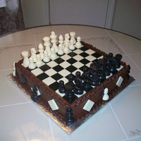 "Chess Cake 12"" square cake. All the pieces are made from white and dark chocolate."