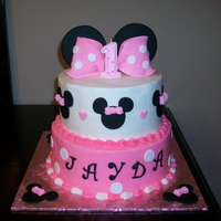 "Minnie Mouse Birthday Cake 8"" and 10"" cakes iced in buttercream w/fondant decorations. The bow and ears are gumpaste."
