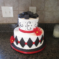 "Bridal Shower Cake  Black and red theme bridal shower cake. 10"" and 6"" cakes. White buttercream, black and red fondant accents, red ribbon. Gumpaste..."