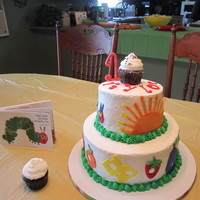 "Very Hungry Caterpillar Cake  10"" and 6"" cakes. Buttercream. Fondant foods, sun, caterpillar from Eric Carle's book. Small cupcake for the ""smash&..."