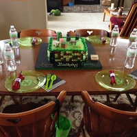 "Minecraft 2 layer, 12"" square cake. Used buttercream ""petal"" technique for the sides. Minecraft toys on top. (I didn't want or..."