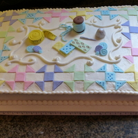Quilt Cakes 12x18 chocolate sheet cake. Buttercream icing, fondant quilt pieces and accessories.