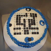 Crossword Cake  Birthday cake for crossword puzzle lover. Had the clues written on cake box. Answers to clues all about family & hobbies. simple 8&quot...