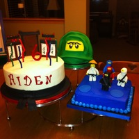 "Lego Ninjago 2 tier 10"" vanilla cake decor with name, black belt (hard to see with black board), ninjago practice arena-like fondant pieces. 2 tier..."