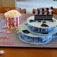 "Movie Birthday one 10"" cake for bottom reel, one 8"" cake for top reel, three 6"" layers for popcorn tub. Fondant reels used template found..."
