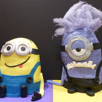 Minion Cakes  Yellow minion: 3, 6 in. cakes + half ball cake. Purple minion: 4, 6 in. cakes + half ball cake. Buttercream with fondant accents (my kids...
