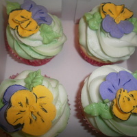 Flower Cupcakes More flower cupcakes. Pansies made out of Royal Icing.