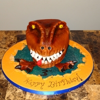 Dinosaur Head 1st cake i've done in over 2years. went better than I expected....not as bad as it could have...lol