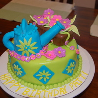 Watering Can Garden Birthday Cake Cake for my mother in law who loves to garden. Cake is checkerboard vanilla and chocolate fudge cake with whipped vanilla icing between the...