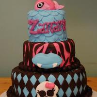 Monster High Bday Cake Monster High themed cake. bday girl's favorite doll is Lagoona Blue whose pet is the piranha. mom wanted the lips and skull...I knew...