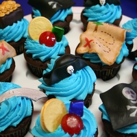 Pirate Cupcakes  Pirate-themed cupcakes for a pirate treasure hunt birthday party. Cupcakes are dark chocolate with caramel filling and blue buttercream...