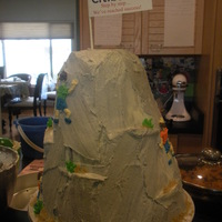Mountain Made for a Citibank conference. Chocolate cake with cheesecake mousse filling. BC frosting and climbers.