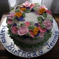 Jennie's Birthday Garden This is an 8 inch three layer pound cake. It is filled with buttercream and the flowers are royal icing.I made the cake for my Great Aunt&#...