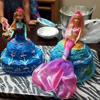 Anna And Mermaid Cake Both Yellow Cake With Buttercream Frosting And Barbies In Them Anna and mermaid cake both yellow cake with buttercream frosting and Barbie's in them.