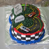 3Rd Birthday Racetrack   This was made for my grandson's third birthday. One side is red velvet and the other is lemon raspberry.
