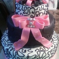 Black And Pink Bridal   French vanilla cake with lemon raspberry filling. covered in fondant with fondant decorations. Oh how I dislike BLACK fondant!!!!!! TFL