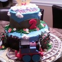 Thomas Train Birthday  I made this for my grandson....he LOVES Thomas..Vinnie will sit and watch that show for hours...The idea comes from a few cakes on this...