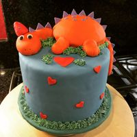 Dinosaur Valentine Cake Dino body is cake, with fondant limbs and head.