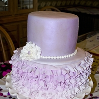 "Purple Ruffles 10"" and 7"", fondant ruffles. The photos dont do the top tier justice. it was brushed with a violet pearl luster dust and then..."