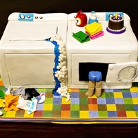 Laundry Lover This birthday cake was made for a little boy who is OBSESSED with washer, dryers and anything laundry.