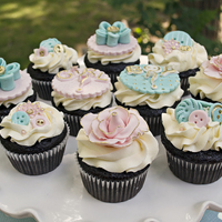 He Or She...what Will It Be? Gender Reveal  Cupcakes created for a gender reveal party. It was kind of fun being the only one who knew what the couple was having. Decorations are all...
