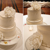 Vintage {Lace} Sugarveil lace and gumpaste peony flowers. covered in ivory fondant then dusted with gold pearl luster.