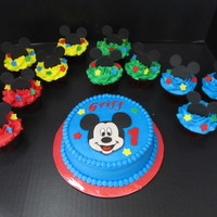 Mickey Mouse Smash And Cupcakes Mickey mouse cupcakes, frosting in primary colors with fondant mickey heads and stars, matching smash cake with fondant Mickey face, stars...