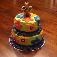 Flower Scooby-Doo 2 tier with Scooby-Doo candle for my niece's 4th birthday. Used the Mystery Machine colours and flowers for the cake. She loved it, it...